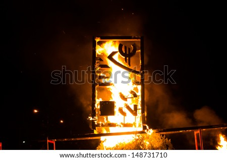 The symbol of euro on fire, an art installation - stock photo