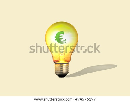 The symbol of the Euro in a lit, transparent lightbulb