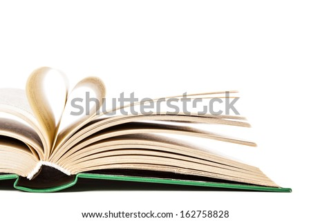 the symbol of the heart of the old pages of an open book on a white background - stock photo