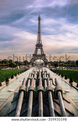 The symbolic architecture of France, Eiffel tower, in evening cloudy day. This picture was taken from Trocadero, Paris, France. - stock photo
