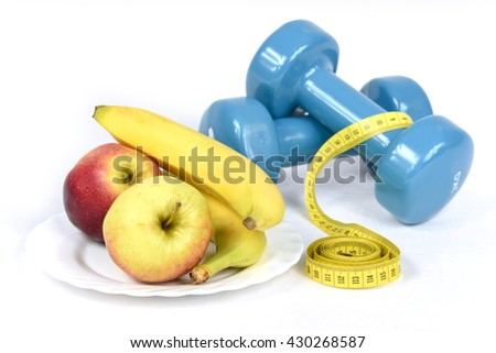 The symbols of a healthy lifestyle - gymnastics, weight control, and fruits