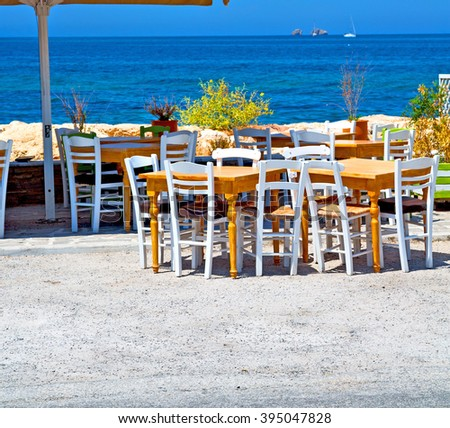 the table       in santorini europe        greece old restaurant chair    and summer - stock photo