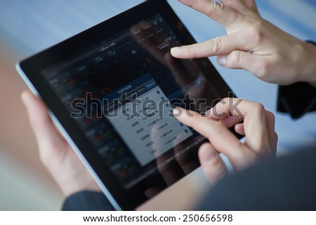 the tablet in hands