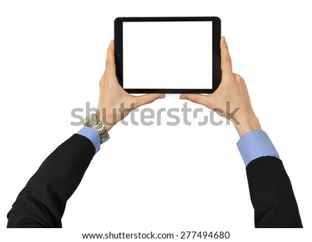The tablet in male hands with clipping path for the screen isolated on white background - stock photo