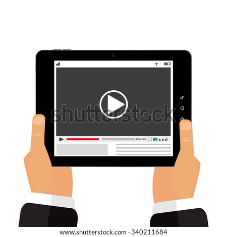 The tablet in the hands  of a video player - stock photo