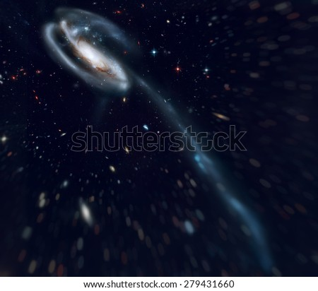 The Tadpole Galaxy (UGC 10214) is a disrupted barred spiral galaxy in the northern constellation Draco. Retouched image with small DOF. Elements of this image furnished by NASA. - stock photo