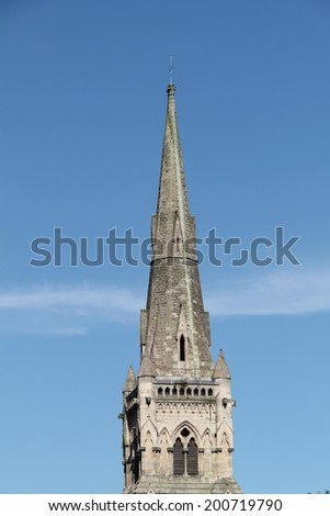 The Tall Spire of a Classic English Church. - stock photo