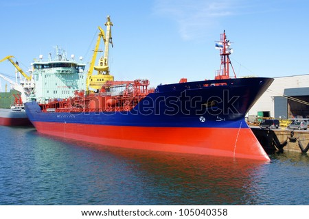 The tanker is moored in the port - stock photo