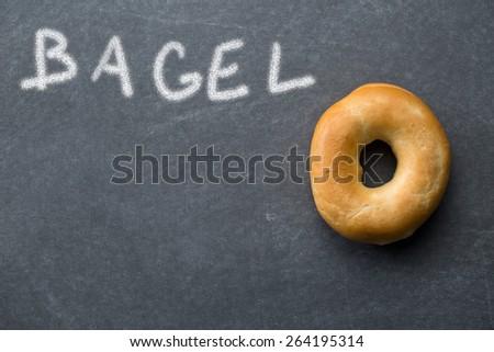 the tasty bagel on chalkboard - stock photo