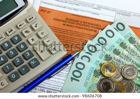 The tax form with calculator, money and pen. - stock photo