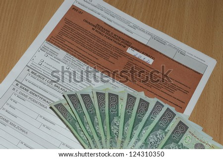 The tax form with money - stock photo