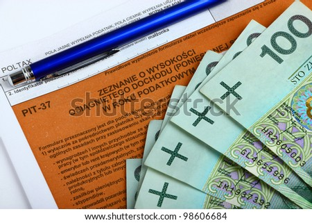 The tax form with money and pen. - stock photo