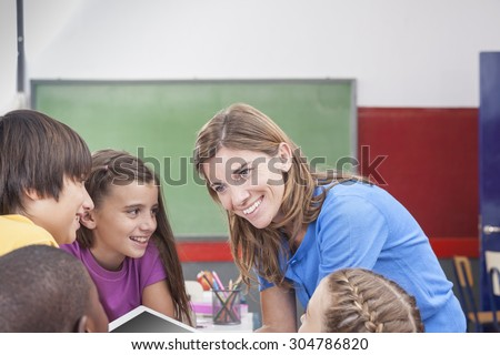 The teacher showing something - stock photo