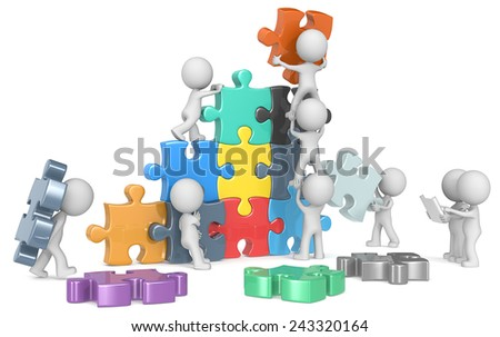 The Team. The dude x 9 building colorful puzzle from blueprint.  - stock photo