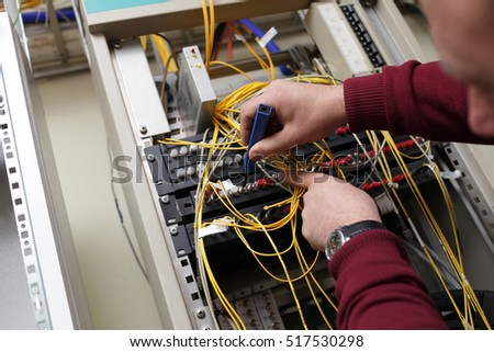The technician cleaning fiber optic on the telecom site