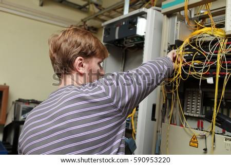 Technician Working On Telecom Room Stock Photo 590953220 - Shutterstock
