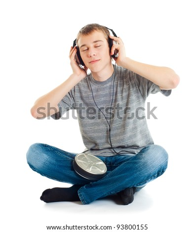The teenager listens to music in ear-phones - stock photo