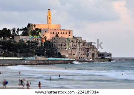 The Tel Aviv promenade at sunset.The lights of Jaffa at sunset  - stock photo