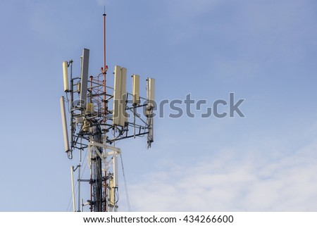The telecommunication  antenna tower with the blue sky background. - stock photo