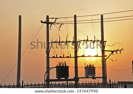 The telegraph poles and wires in the sunset  - stock photo