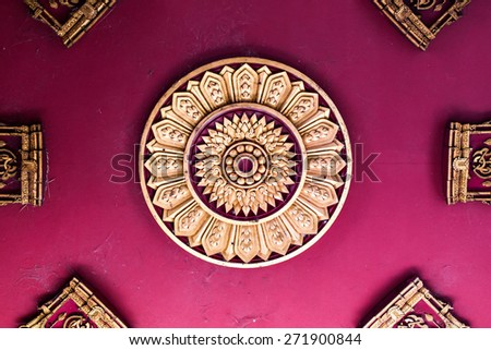 The temple ceiling is decorated so beautiful. detail form decoration of temple of  wat Phakaow, Thailand. - stock photo