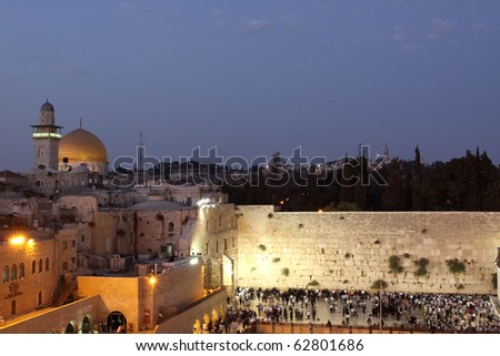The Temple Mount in Jerusalem, including the Western Wall and the golden Dome of the Rock at Sunset - stock photo