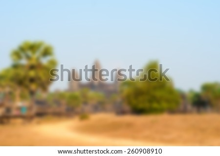 The temple of Angkor Wat defocused as a blurred background - stock photo