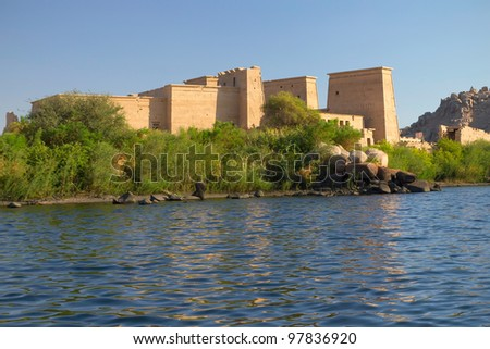 The Temple of Isis at Philae island in Lake Nasser, seen from a boat. Near the town of Aswan ( Egypt). Horizontally. - stock photo