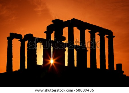 The Temple of Poseidon (ancient God of the Sea), at cape Sounion, at sunset, close to Athens, Attica, Greece