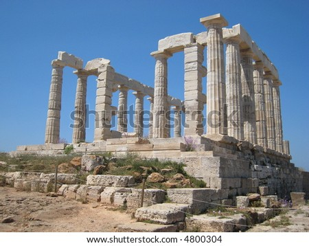 The temple of Poseidon at Sounion, Greece. Beautiful white washed marble over looking the sea. One of the columns has the early graffiti of Lord Byron on it.