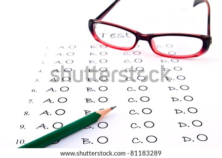 The test list and pencil and glasses  on the examination - stock photo