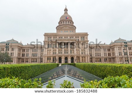 The Texas State Capitol Building with a view of the modern extension in downtown Austin. The building was built in 1882-1888 of distinctive sunset red granite. - stock photo