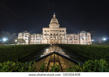 The Texas State Capitol Building with a view of the modern underground extension in downtown Austin at Night. The building was built in 1882-1888 of distinctive sunset red granite. - stock photo