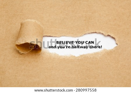 The text Believe you can and you're halfway there, appearing behind torn brown paper. Motivational quote.