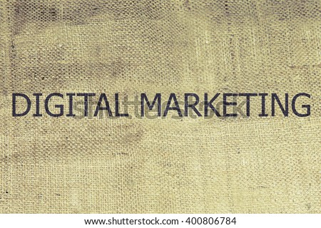 The text digital marketing on brown burlap. Retro burlap background. vintage
