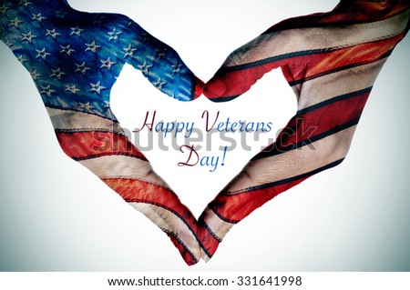 the text happy veterans day and the hands of a young woman forming a heart patterned with the flag of the United States - stock photo