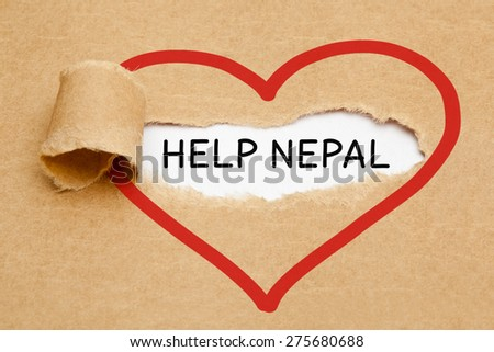 The text Help Nepal appearing behind torn brown paper.  - stock photo