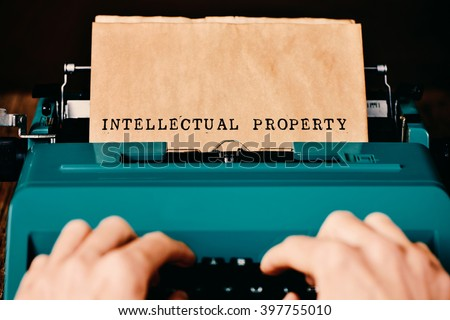 the text intellectual property written in a yellowish paper with a retro typewriter - stock photo