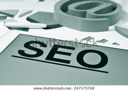 the text SEO, for Search Engine Optimization, in the screen of a tablet - stock photo