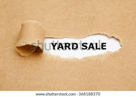The text Yard Sale appearing behind torn brown paper.  - stock photo
