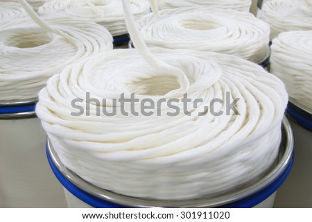 The textile workshop, spool piled up together, neat rows - stock photo