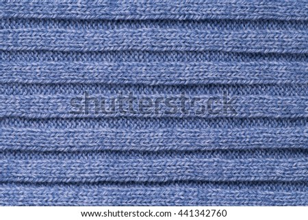 The texture of a knitted woolen cloth is blue, with a ribbed pattern stripes. background - stock photo