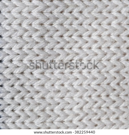 The texture of knitted fabrics white color - stock photo