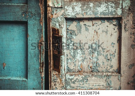 The texture of old door, which the old paint flaking. The texture of old door, which the old paint flaking - stock photo