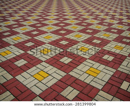 The texture of perspective colored checkered tile in the street - stock photo