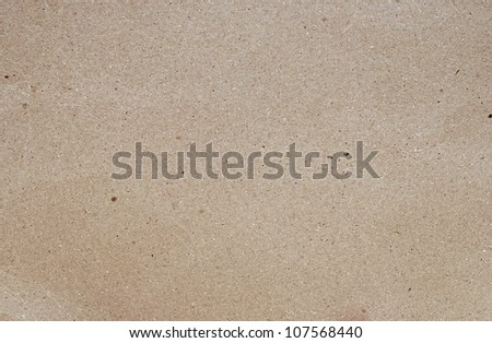 The texture of recycled paper. Useful as background. - stock photo