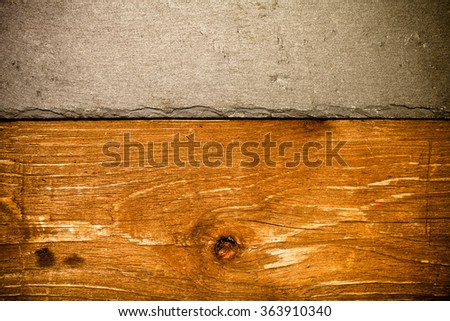 The texture of slate and wood for the background. Toned.