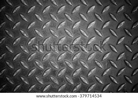The texture of steel pavement in monochrome.
