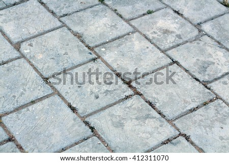The texture of stone. Old gray pavement. Picture can be used as a background. - stock photo