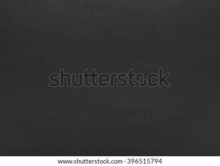 the texture of the black paper as background - stock photo